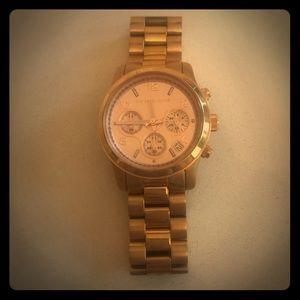 Michael Korda gold watch